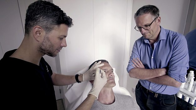 Dr Wassim Taktouk injects dermal filler into a patient's tear trough area, watched by Dr Michael Mosley